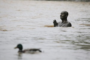 The statue of Indian spiritual leader Sri Chinmoy, before it was submerged under the rising water from the Vltava river on Kampa Island in Prague, Czech Republic [Photograph: Vova Pomortzeff/Demotix/Corbis]