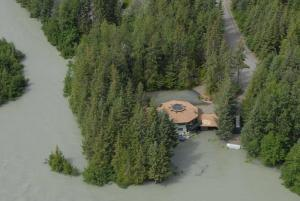 Home on the Mendhenhall River is surrounded by water on Thursday, July 21, 2011.