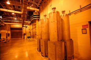 Six empty stainless steel canisters are stored in the Defense Waste Processing Facility at the Savannah River Site. NYT