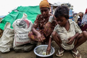 A Rohingya family have a meager meal in a camp for displaced Muslim families near Sittwe in May 2013. (Photo: Jpaing / The Irrawaddy)