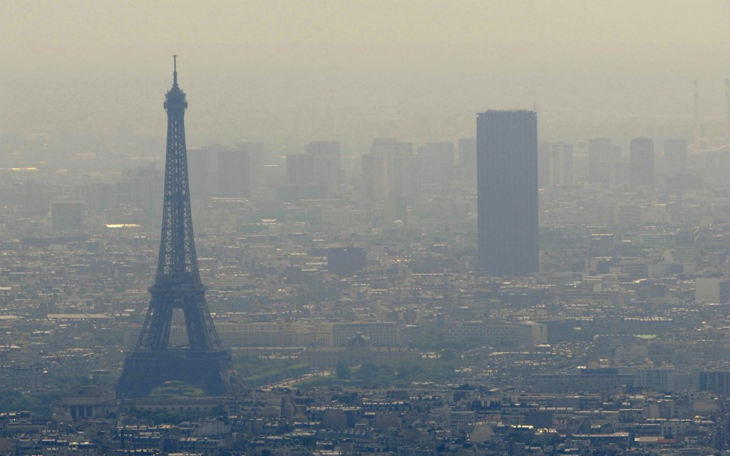 An aerial picture taken aboard an helicopter on July 20, 2010 shows a smoggy view of the Eiffel tower (L) and the Tour Maine-Montparnasse in Paris. (BORIS HORVAT/AFP/Getty Images)