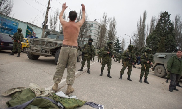 A Ukrainian soldier tries to persuade Russian troops to move away from a Ukrainian military base in Balaklava, Crimea on Saturday. Photograph: Anton Pedko/EPA
