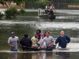 Residents of the Florida Panhandle were rescued in April after flooding caused by rains. [Credit Bruce Graner/Pensacola News Journal, via Associated Press]