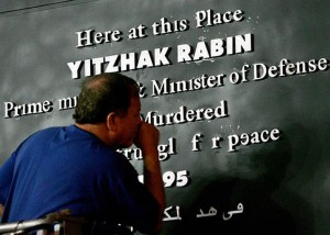 A worker fixes a new memorial sign for the late Israeli prime minister Yitzhak Rabin in the centre of Tel Aviv November 3, 2005. Ten years after Prime Minister Yitzhak Rabin was shot at a peace rally by an ultranationalist opposed to his talks with the Palestinians, the Jewish state is seeing a resurgent swirl of rumour and speculation about his death.